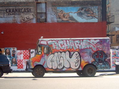 Colour photo of a graffiti covered van